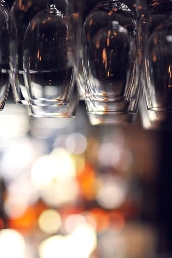 Upside down view of empty wineglasses