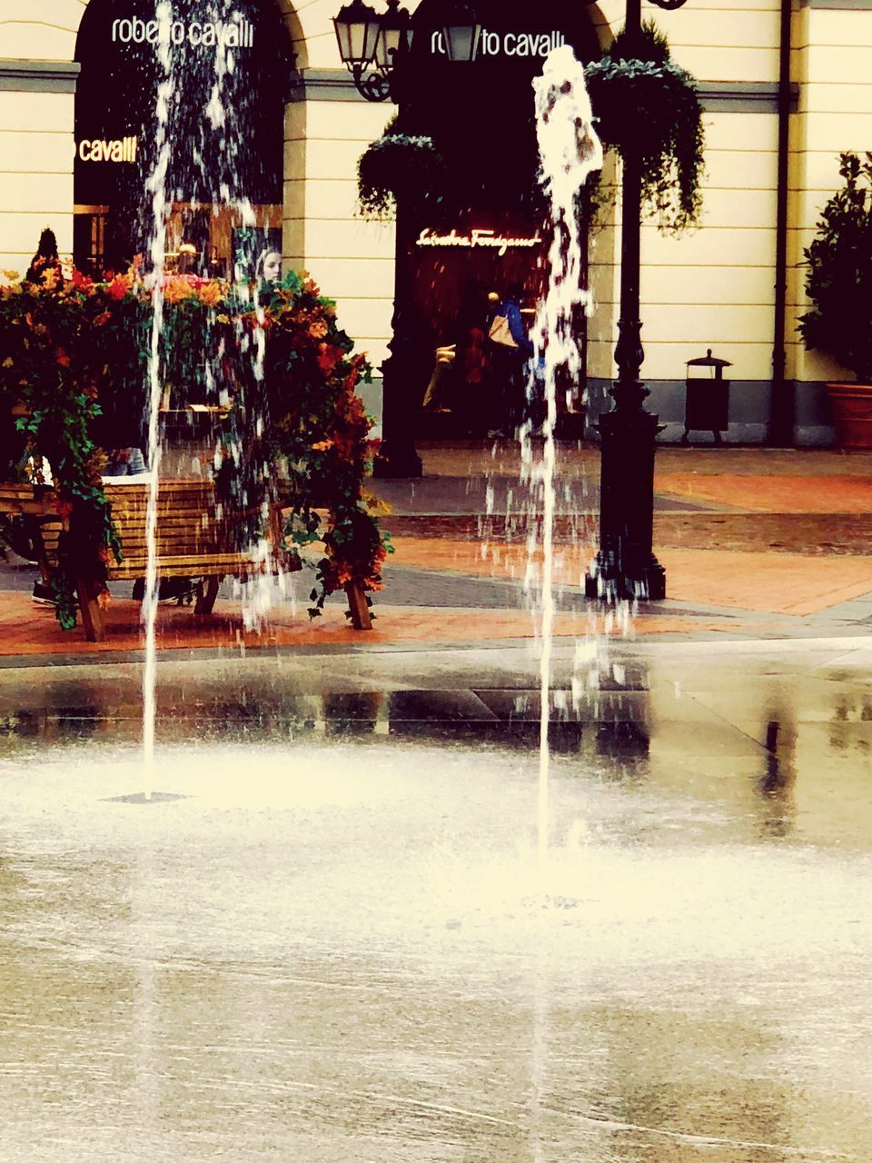 water, architecture, motion, built structure, fountain, wet, reflection, day, spraying, long exposure, nature, building exterior, outdoors, city, real people, blurred motion, incidental people, building, splashing, rain
