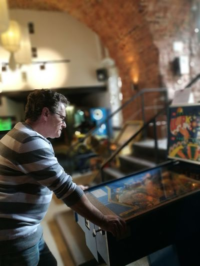 EyeEm Selects Flipper Arcade Games One Man Only Only Men Adults Only One Person Indoors  Adult People Men Real People Relaxing Pinball Pinballmachines Pinball Machine