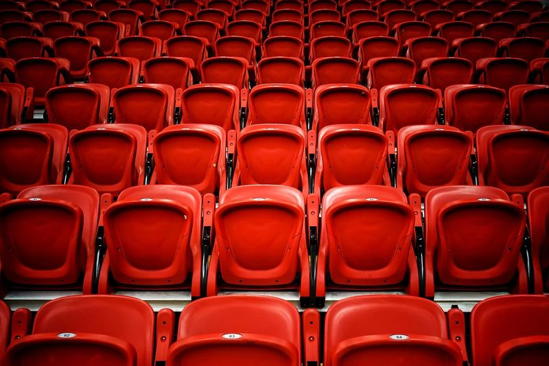 Full frame shot of empty red bleachers in stadium