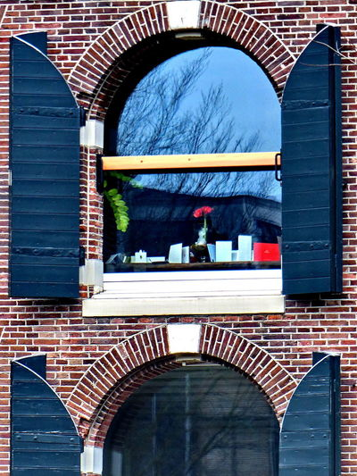 Wooden Shutters Arch Architecture Brick Wall Building Exterior Built Structure City Day No People Outdoors Window