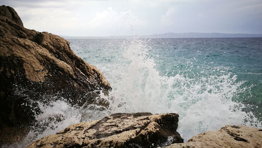 Beauty In Nature Crash Day Force Hitting Horizon Over Water Motion Nature No People Outdoors Power In Nature Rock Rock - Object Rough Sea Sky Water Wave