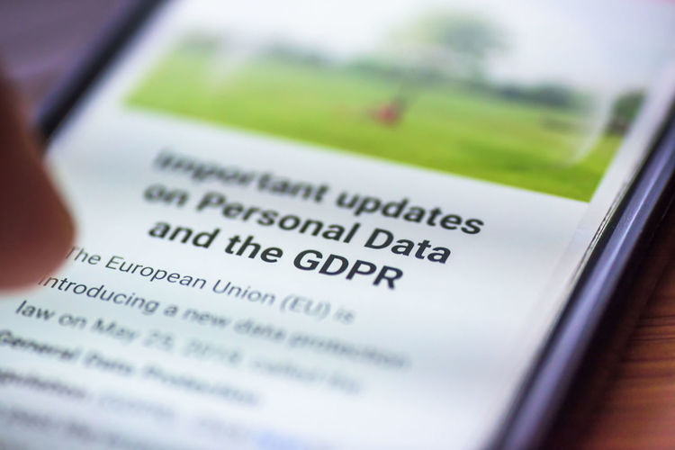 General Data Protection Regulation - closeup human finger pointing to smartphone screen message with text GDPR Analyzing Business Close-up Communication Data Economy Finance Gdpr Indoors  Number Paper People Preparation  Privacy Selective Focus Studio Shot Technology Text Tray Western Script