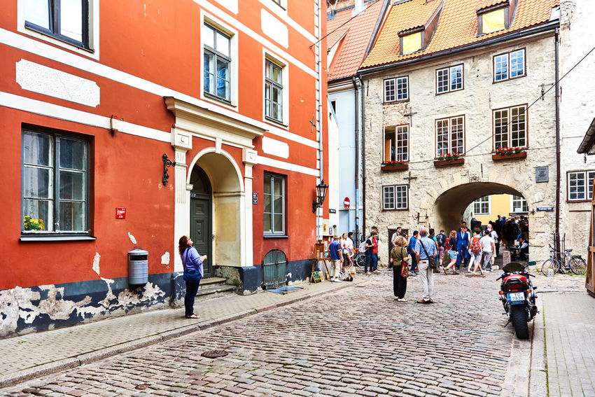 Riga, Latvia - July 19, 2016: Tourists walking in the old town of Riga. Northern Europe. Latvia Architecture Baltic Countries Baltic States Capital Cobblestone Streets Crowd Of People Day Editorial  Europe Exterior History Landmark Latvia Northern Europe Old Riga Old Town Pedestrian Walkway People Riga Latvia Summer Summertime Tourism Tourists Travel Destinations