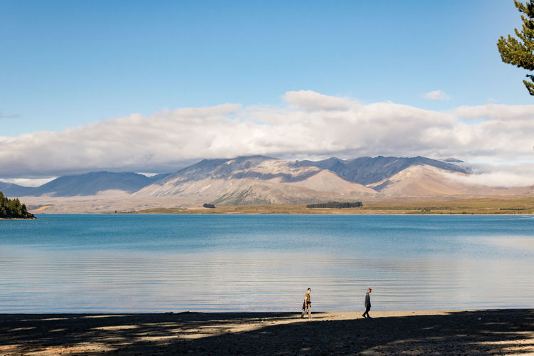 Walking in beauty Water Mountain Sky Beauty In Nature Scenics - Nature Lake Tranquil Scene Nature Tranquility Real People Standing Mountain Range Lifestyles Non-urban Scene Two People Leisure Activity Day Cloud - Sky Outdoors New Zealand Scenery