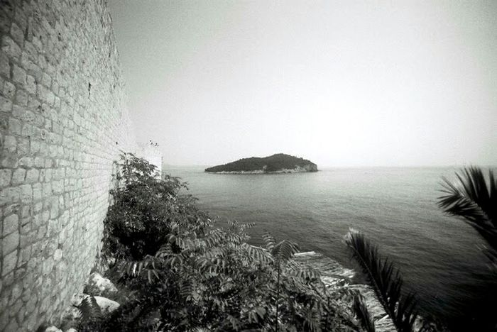 Seaside Black And White Analog Photography Analog Film Wall Rocks Stones Water Ultra Wide Angle Dubrovnik view to Island Lokrum