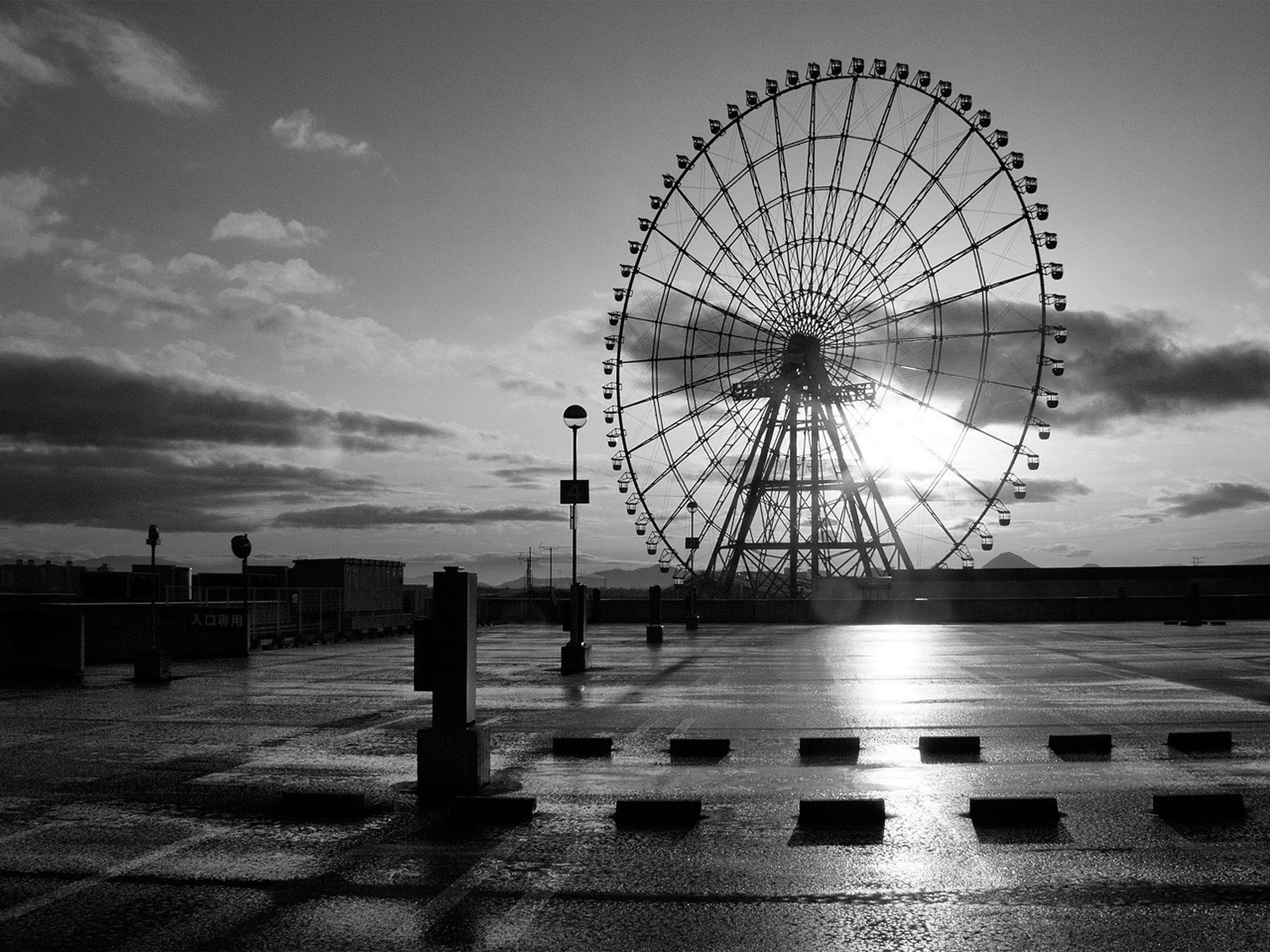 ferris wheel, amusement park ride, sky, amusement park, arts culture and entertainment, water, cloud - sky, silhouette, low angle view, built structure, sea, incidental people, sunset, outdoors, circle, cloud, day, architecture, sunlight, nature