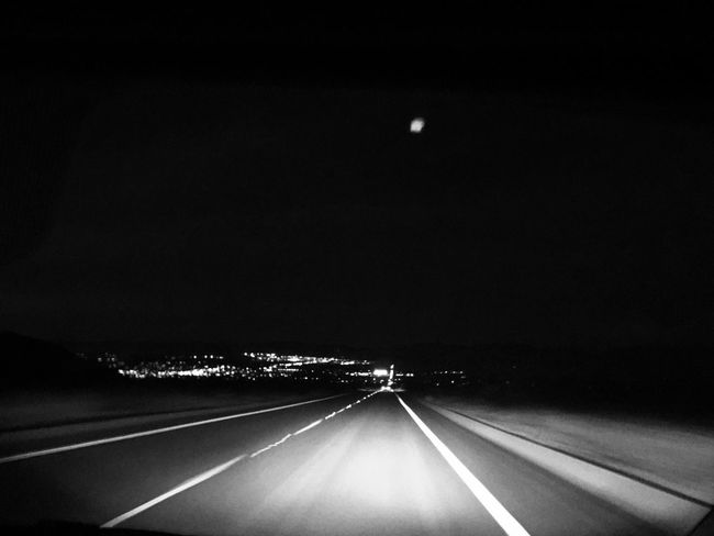 Midnight Drive EyeEmNewHere Empty Road Blackandwhite Transportation Road Car Motor Vehicle Night Mode Of Transportation Symbol The Way Forward Direction Highway No People Motion HUAWEI Photo Award: After Dark