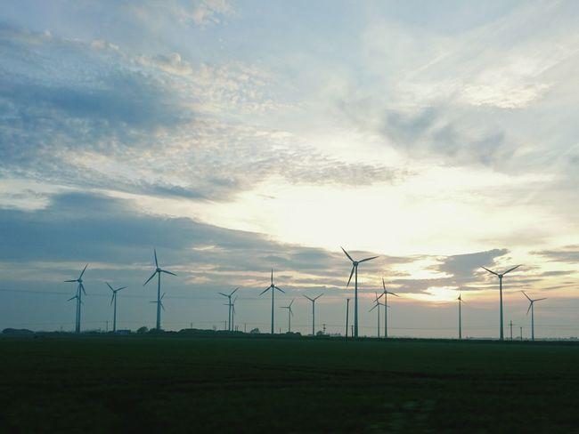 Sunset Silhouettes Wind Turbine Homeward Bound