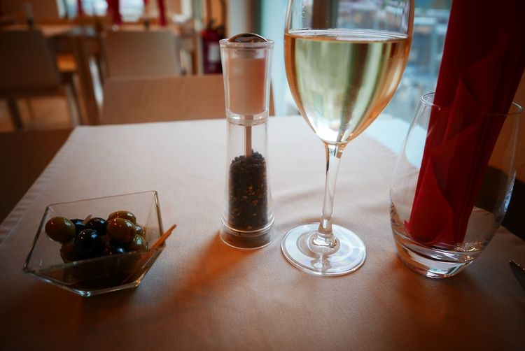 White wine and olives on table in restaurant