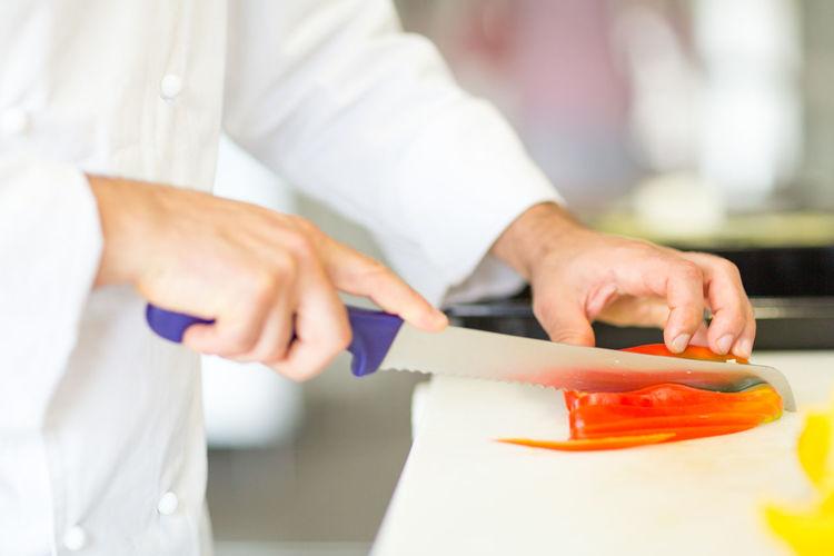 Close-up of chef preparing food