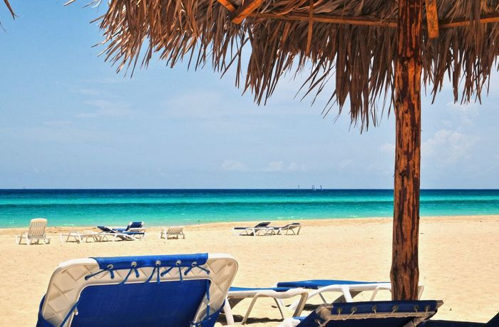 Varadero Varadero Varadero, Cuba Varadero Beach - Cuba Cuba Cuba. Varadero Cuban Beach Paradise Beach Relaxing Moments Relax Time  Blue Sea Blue Water Sandy Beach Hollyday Summertime Summer Days Summer Holidays Sitting On A Bench Water Tree Sea Beach Relaxation Sand Chair Summer Cafe Tropical Climate Beach Umbrella Seascape Turquoise Colored
