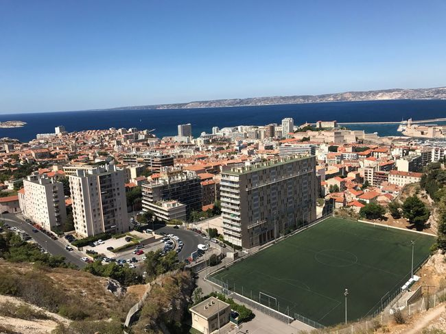 Architecture Built Structure Building Exterior High Angle View Sea Clear Sky Residential Building Day Cityscape Outdoors Horizon Over Water Sky Blue City Sunlight No People Town Water Nature Mountain Footballfield