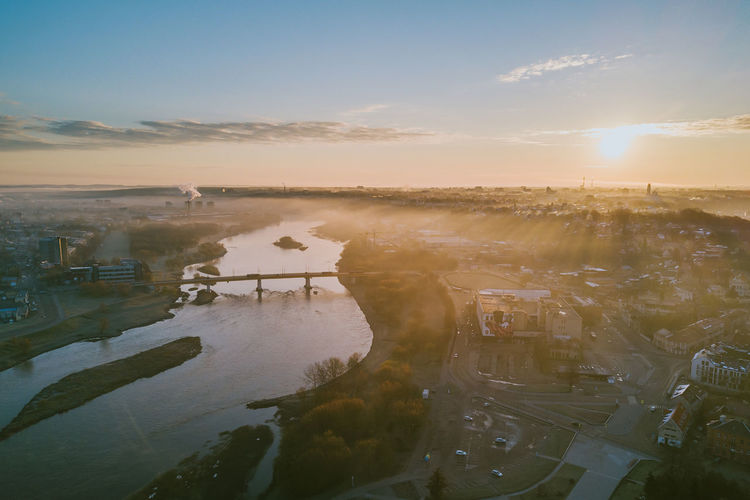 Fog over the city Architecture Beauty In Nature Building Exterior Built Structure City Day Drone  Europe Fog Over The City Foggy Morning High Angle View Lietuva Mavic Mavic Pro Nature No People Old Town Outdoors Sky Springtime Sun Sunlight Sunset Tree Water