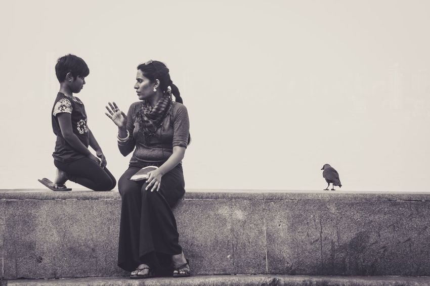 A patient ear to motherly advice in Worli, Mumbai People Full Length Old-fashioned Bird Outdoors Day Only Men Sky Young Adult Portraits Canonphotography Magnumphotos Natgeotravel Lensculture Mothers Day The Street Photographer - 2017 EyeEm Awards Street Photography India Crow Human Face Real People EyeAmNewHere The Portraitist - 2017 EyeEm Awards Instruction Mother & Daughter Live For The Story BYOPaper! EyeEmNewHere