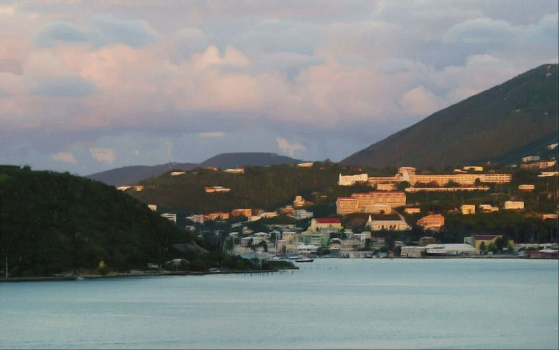 Coming Into The Island! Ocean Village Mountains And Sky Ocean Bay Hillside Houses.
