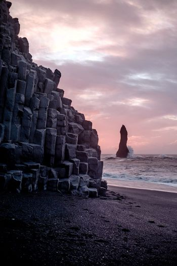 Monument (Find me on IG @noeldxng) Sunset Travel Destinations Beach Rock - Object Landscape Tranquility Cloud - Sky No People Water Outdoors Scenics Beauty In Nature Perspectives On Nature Be. Ready. Adventure The Week On EyeEm Beauty In Nature Rural Scene Iceland Black Sand Beach Sand A New Beginning Capture Tomorrow
