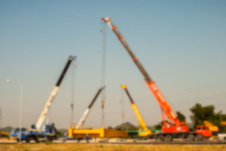 Construction site against clear blue sky