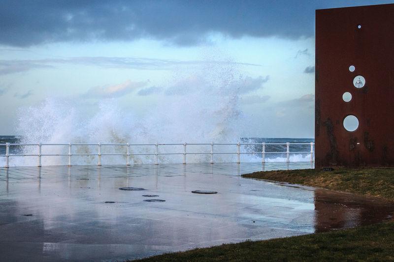 Wave splashing against wall in winter.