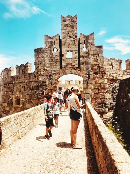 My holiday 2018 - Gate of St Paul, Rhodes Greece ThoughtsOfTheDay Historical Landmark Tourists Every Day People Doing Everyday Things Travelling ✈ Travel History Throughmyeyes GREECE ♥♥ So Surreal EyeEmNewHere Itookthisphoto Real People Sky Sunlight Architecture Built Structure Nature Lifestyles Building Exterior People Day Togetherness Travel The Past