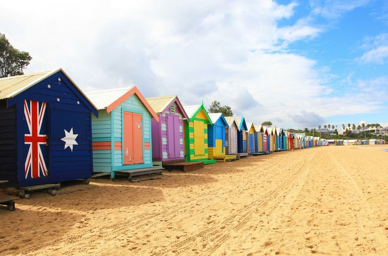 Multi-colored wooden built structures on beach
