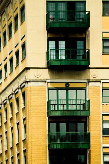 Apartment Architecture Backgrounds Balcony Building Building Exterior Built Structure City Contrast Façade Full Frame Glass - Material Hostel Hotel Low Angle View Modern Motel No People Outdoors Pastel Yellow Patel Reflection Repetition Residential Building Residential Structure