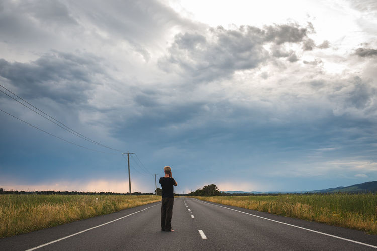 A Traveller walks down an empty road in Australia Art Australia Exploring Feilds Lndscape Lone Photography Road Roaming Storms Travel Traveller Walking Around Wanderlust Water Wonderlust