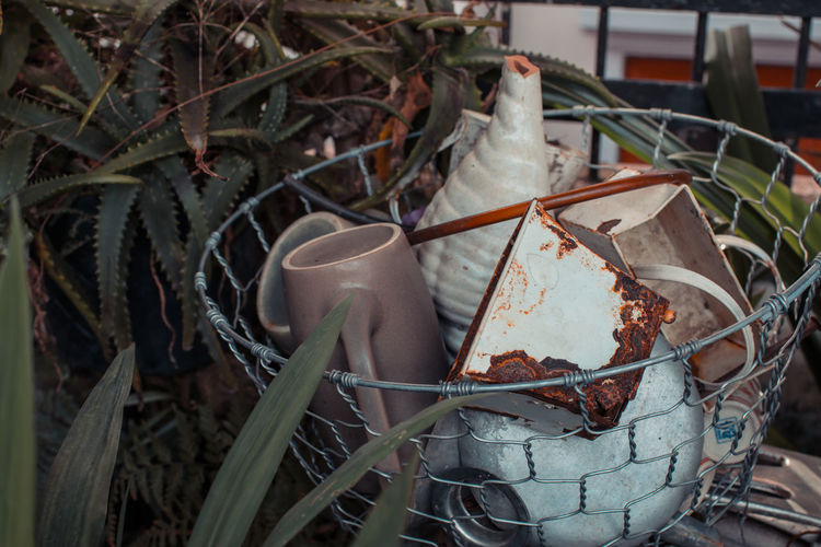 Vintage metal kettle and cup. White rusty metal cup containe Cup of English tea No People Plant Close-up Nature Day Growth Focus On Foreground Container Outdoors Leaf Plant Part Food Metal Abandoned Cold Temperature Food And Drink Obsolete Damaged Frozen Freshness Vintage Backgrounds Old Working Burning Camping Cup Junk Fence Colours Handle Spout Object Camping Equipment Design Hot Light Dark Closeup Tiny Tin Antique Rustic Rustic Style Dirty Collection Equipment Rusty Rusty Metal Drinking