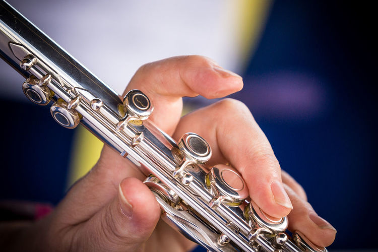 Close-up of hands playing musical instrument