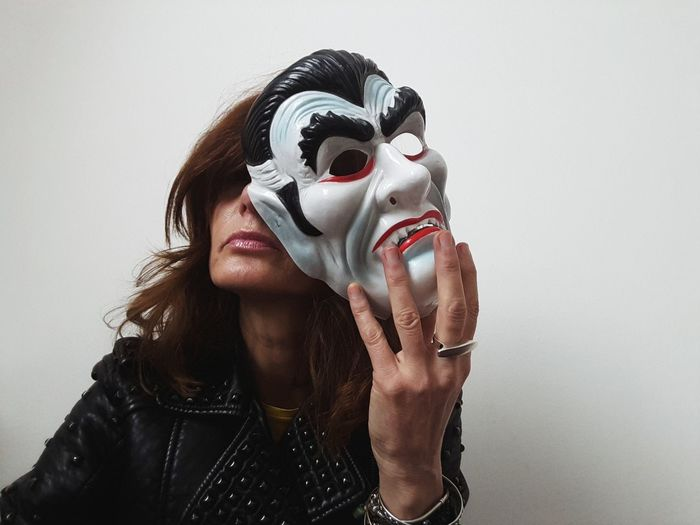 mask White Background Portrait Of A Woman Women Of EyeEm Hands Faces Of EyeEm Lips Mime Portrait Disguise Smiling Party - Social Event Women Cheerful Fun Spooky Headshot Eye Mask Carnival Face Guard - Sport Mask - Disguise Mask