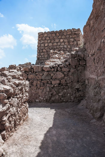Inside the ruins of the fortress of Masada in Judaean Desert in Israel Ancient Antique Archaeology Architecture Castle Landmarks Massada National Park Ruins Travel Wall Cultures Day Dead Sea  Famous Place Fort Heritage History Israel Judean Desert Mountains Nature Old Stone Tourism