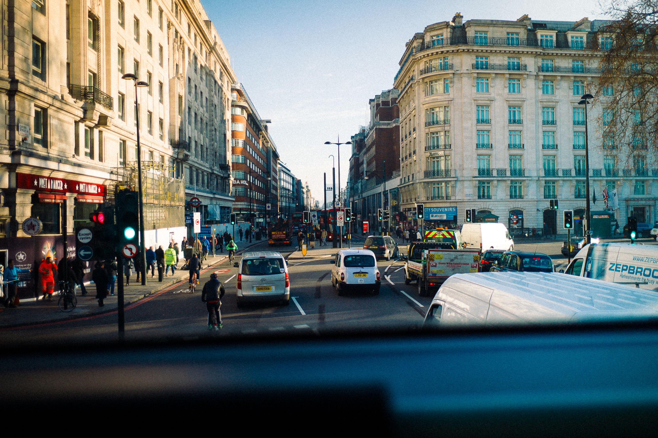 city, car, street, city street, transportation, city life, mode of transport, building exterior, built structure, architecture, yellow taxi, outdoors, sky, no people, day