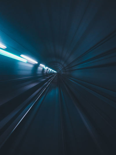 Blurred motion of railroad track in tunnel