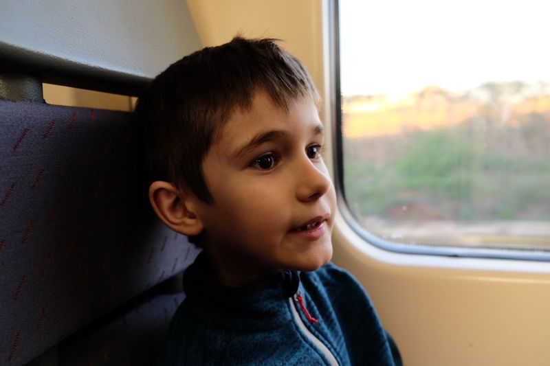 Close-up of boy sitting in train