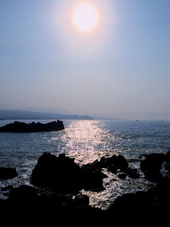 Sea Sun Water Beauty In Nature Sunlight Horizon Over Water Scenics Nature Rock - Object Tranquility Beach Tranquil Scene Sunset No People Reflection Outdoors Sky Silhouette Wave Clear Sky