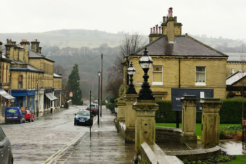 Built Structure Architecture Outdoors No People Day Perspective Street Saltaire Bradford Mill Town Rainy Day Old Buildings Architecture Building Exterior Titus Salt Scenics Cobbled Streets Lamp Post Road Wet Homes Street Photography POV Houses