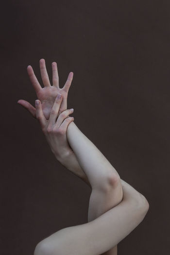 Cropped image of woman hand against black background