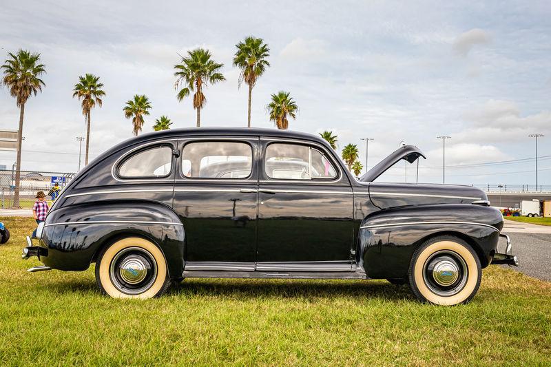 Vintage car on land against sky