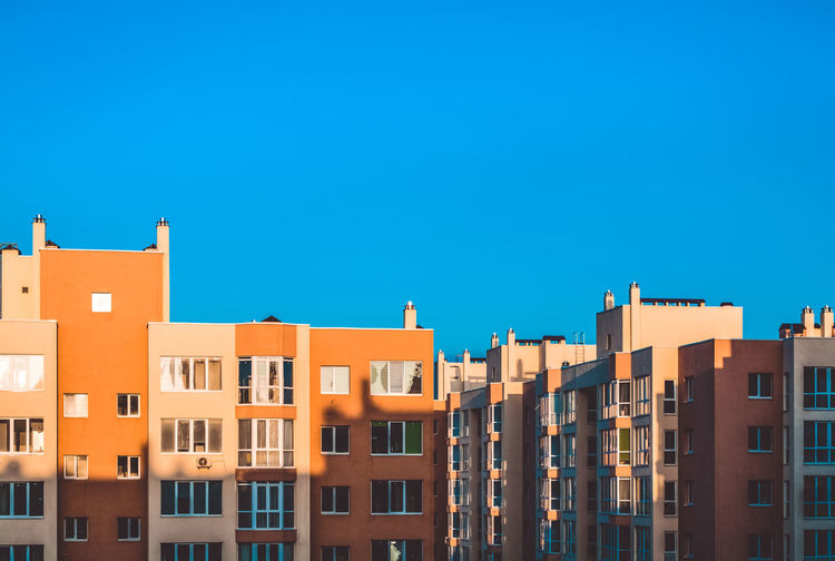 Architecture Built Structure Building Exterior Building Copy Space Sky Blue Residential District Clear Sky Window No People City Sunlight Nature Day Outdoors Multi Colored Apartment In A Row House Row House