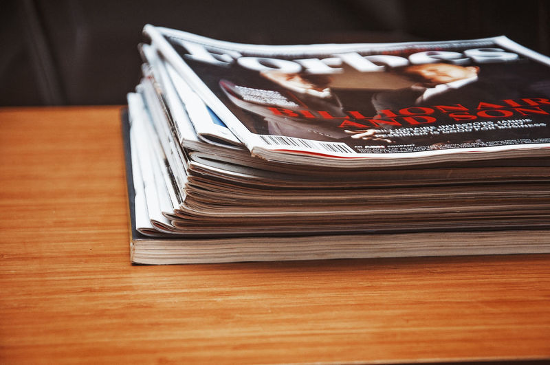 Magazines Stack On A Table Table Still Life Indoors  No People Paper Close-up Large Group Of Objects Publication Communication Book Focus On Foreground Wood - Material Selective Focus Business Education Text Abundance Brown Learning Office