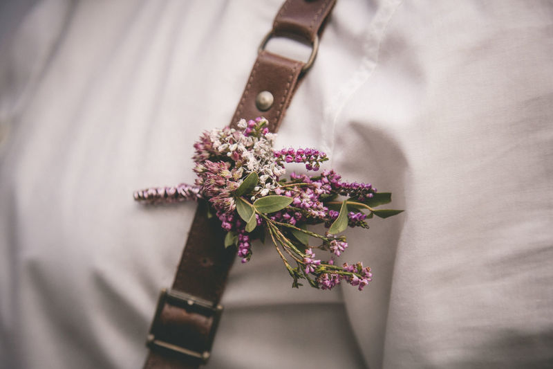 Cropped image of person with suspenders and flowers