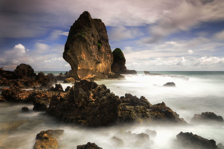 Rock formations of Aerguling beach Rock Sea Cloud - Sky Sky Solid Rock - Object Water Scenics - Nature Beauty In Nature Rock Formation Land Nature Tranquility Tranquil Scene No People Motion Beach Day Long Exposure Horizon Over Water Outdoors Stack Rock Power In Nature