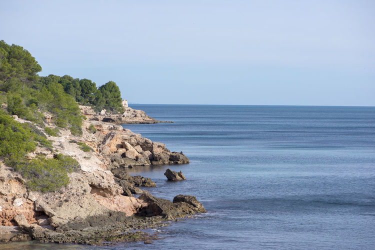 Tarragona Costa Daurada Sea Water Beauty In Nature Sky Rock Scenics - Nature Horizon Over Water Horizon Tranquil Scene Rock - Object Land Tranquility Nature Beach Solid Rock Formation Clear Sky No People Day Outdoors Rocky Coastline