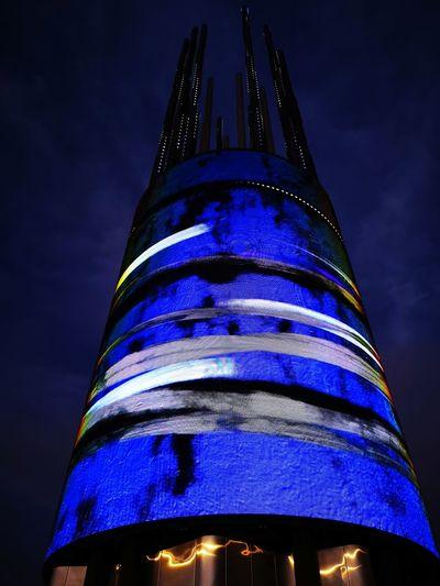 Imposing. Modern Multi Colored Illuminated Skyscraper Blue City Sky Architecture Building Exterior Built Structure