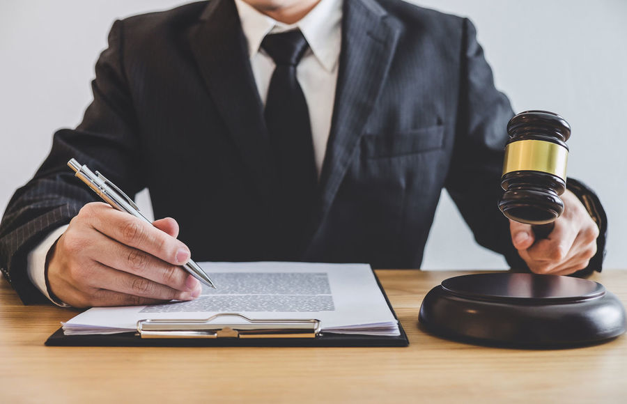 Lawyer Adult Advocate Balance Barrister Business Business Person Businessman Consultant Counselor Document Fairness Gavel Hand Holding Judge Judgement Legal Legislation Notary Occupation Paper Suit Verdict Well-dressed