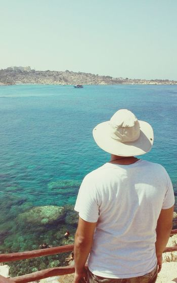 Horizon Over Water Descovering Places People Crystal Sea Waters Blue Sea Clear Sea Sailing Clear Waters Man Looking Man Looking At Sea Man Wearing Blue Sky Hut Hot Day Travel Photography
