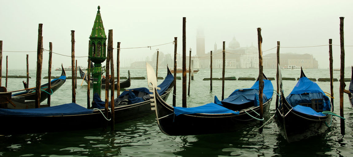 Transportation Gondola - Traditional Boat Water Mode Of Transportation Moored Travel Destinations Wooden Post Canal Travel Wood - Material Architecture Tourism No People Outdoors Venice, Italy Tourists Attraction Minimalism Foggy