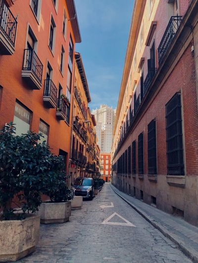 Colorful SPAIN Tourism Alley Madrid Building Exterior Architecture Built Structure Car City Motor Vehicle Building Mode Of Transportation Street Transportation Residential District The Way Forward Diminishing Perspective Land Vehicle Sky Direction Outdoors Nature Road No People