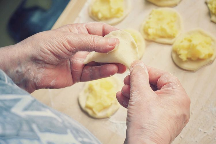 Cropped Image Of Person Making Dumpling