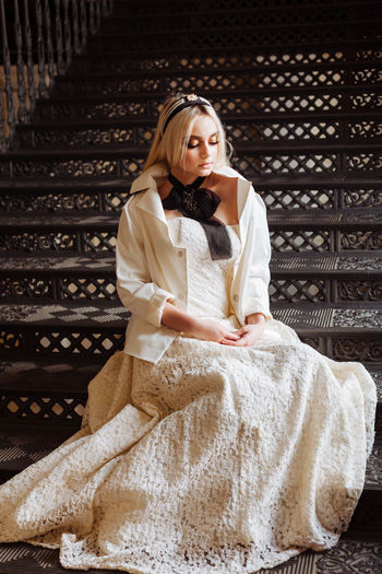 Fashion Stairs Wedding White Dress Beautiful Woman Black Black Stairs Blackandwhite Clothes Day Depression - Sadness Fashion Clothes Front View Full Length Lifestyles Sad Mood Sitting Wedding Dress Wedding Fashion
